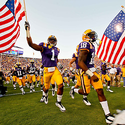 September 10, 2011; Baton Rouge, LA, USA;  LSU Tigers safety Eric Reid (1) carries a United States flag in remembrance of the anniversary of the September 11th attacks as the team takes to the field prior to a game against the Northwestern State Demons at Tiger Stadium.  Mandatory Credit: Derick E. Hingle