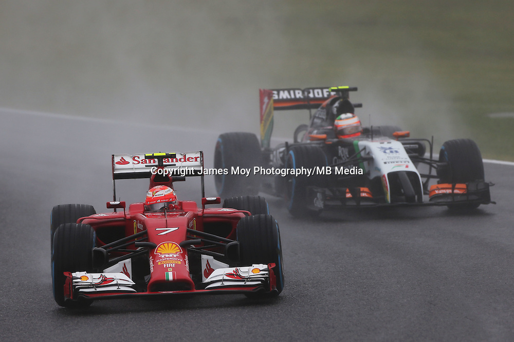 Kimi Raikkonen (FIN) Ferrari F14-T leads Sergio Perez (MEX) Sahara Force India F1 VJM07.<br /> Japanese Grand Prix, Sunday 5th October 2014. Suzuka, Japan.