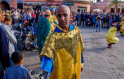 Collecting money from tourists for the men playing drums and performing a traditional dance in the Jemaa el Fna, Marrakech, Morroco, North Africa<br /> <br /> (c) Andrew Wilson | Edinburgh Elite media