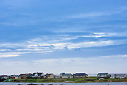 Holiday cottages along The Wash estuary in Snettisham, North Norfolk coast, East Anglia, England, United Kingdom