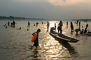 People enjoy the water of the Mekong River in Vientiane the capital of Laos during New Year's celebrations.