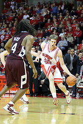 05 January 2008: Randal Falker stands in in the path of a charging Levi Dyer who is being held by Matt Shaw from behind. The Redbirds of Illinois State took the bite out of the Salukis of Southern Illinois winning the Conference home opener for the 'birds on Doug Collins Court in Redbird Arena in Normal Illinois by a score of 56-47.
