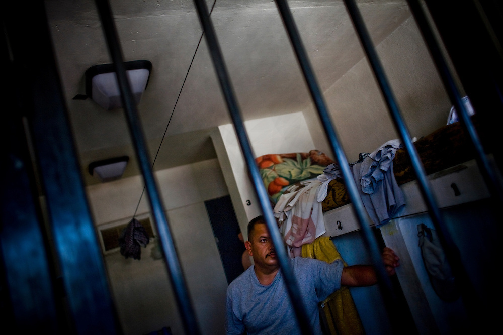 An inmate looks out the bars of his cell outside Ciudad Juarez, Chihuahua on May 26, 2010. The CERESO (Centro de Readaptación Social) is a prison with 620 inmates and houses some of the Mexican state of Chihuahua's most violent criminals.