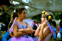 Stock photo of two young girls in fairy costumes at the Texas Renaissance Festival in Plantersville Texas
