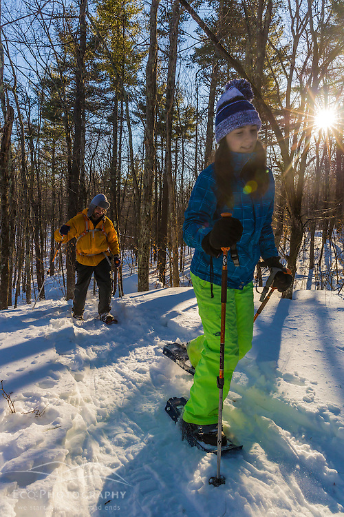 A man and his daughter snowshoeing on Kennard Hill in Epping, New Hampshire.