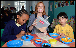 Eastenders actress Patsy Palmer serves breakfast to L to R Aaron Bailey 9, and Jamie Farrell on a visit to Laycock Primary School in Islington, London, to take part in London's Biggest Breakfast. Thursday, 22nd May 2014. Picture by Andrew Parsons / i-Images.<br /> <br /> Patsy Palmer goes back to school to host a hearty breakfast in support of 'London's Biggest Breakfast Campaign' <br /> <br /> The EastEnders Actress is having breakfast with children from Laycock Primary School Breakfast Club in Islington to raise money for London youth charity, the Mayor's Fund for London.
