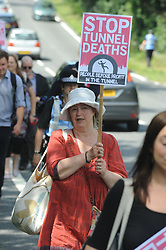 "© Licensed to London News Pictures. 01/08/2015 <br /> Folkestone United PROTESTERS<br /> <br /> Rival groups of protesters are demonstrating over the migrant crisis in Folkestone today.<br /> Campaign group Folkestone United is calling on the UK to ""stand with the Calais migrants"", and is holding the demonstration to highlight the ""deaths of the migrants risking their lives"" to get into the UK.<br /> About 40 banner-waving members demonstrating at the Eurotunnel terminal in Folkestone in Ashford Road have been met by similar numbers from hard right groups including the the English Defence League (EDL) and Britain First, flying Union flags.<br /> <br /> (Byline:Grant Falvey/LNP)"
