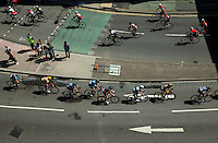 The peloton in the Prudential RideLondon-Surrey Classic stream along Wood Street in Kingston-upon-Thames town centre towards Kingston Bridge on the outbound leg of their race - they pass the tail end of the Surrey 100, the riders of which can be seen going in the opposite direction at the top of the frame.<br /> <br /> <br /> Prudential RideLondon, the world's greatest festival of cycling, involving 70,000+ cyclists – from Olympic champions to a free family fun ride - riding in five events over closed roads in London and Surrey over the weekend of 9th and 10th August. <br /> <br /> Photo: Dillon Bryden for Prudential RideLondon<br /> <br /> See www.PrudentialRideLondon.co.uk for more.<br /> <br /> For further information: Penny Dain 07799 170433<br /> pennyd@ridelondon.co.uk