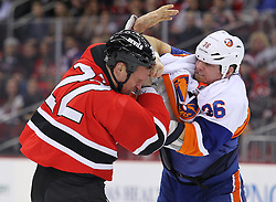 Jan 31, 2013; Newark, NJ, USA; New York Islanders left wing Eric Boulton (36) and New Jersey Devils right wing Krys Barch (22) fight during the first period at the Prudential Center.