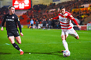 Danny Andrew of Doncaster Rovers (3) and Cauley Woodrow of Barnsley (9) in action during the EFL Sky Bet League 1 match between Doncaster Rovers and Barnsley at the Keepmoat Stadium, Doncaster, England on 15 March 2019.
