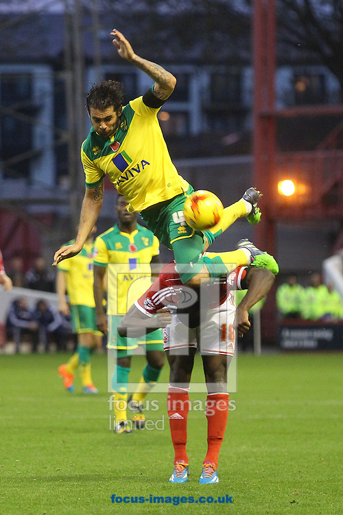 Bradley Johnson of Norwich and Michail Antonio of Nottingham Forest in action during the Sky Bet Championship match at the City Ground, Nottingham<br /> Picture by Paul Chesterton/Focus Images Ltd +44 7904 640267<br /> 08/11/2014