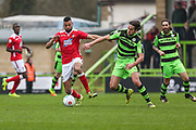 Wrexham's Curtis Tilt(6) shields the ball from Forest Green Rovers Darren Carter(12) during the Vanarama National League match between Forest Green Rovers and Wrexham FC at the New Lawn, Forest Green, United Kingdom on 18 March 2017. Photo by Shane Healey.