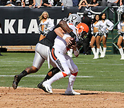 Sep 30, 2018; Oakland, CA, USA;  Cleveland quarterback Baker Mayfield (6) is sacked for a 12-yard loss during his first NFL start by Raiders defensive end Bruce Irvin (51) in a game between the Oakland Raiders and the Cleveland Browns. The Raiders defeated the Browns 45-42 in overtime. Mandatory Credit: Spencer Allen-Image of Sport