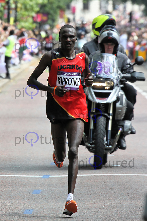 LONDON - AUGUST 12: Stephen Kiprotich wins Gold for Uganda, Abel Kirui wins Silver for Kenya and Wilson Kipsang Kiprotich wins Bronze for Kenya in the Men's Marathon, Birdcage Walk, London, UK. August 12, 2012. (Photo by Richard Goldschmidt)