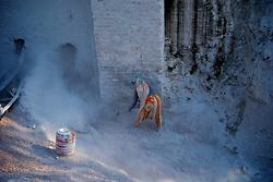 Chitrakoot District, Uttar Pradesh, India: A woman stone worker, crushes stone in the Chitrakoot District of Uttar Pradesh, India.  (Photo by Ami Vitale)
