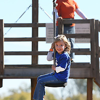 Adam Robison | BUY AT PHOTOS.DJOURNAL.COM<br /> With a big smile on her face, Madelyn Darnell, 5 of Tupelo, coasts down the zipline.