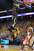 April 30, 2019; Oakland, CA, USA; Golden State Warriors forward Draymond Green (23) dunks the basketball against Houston Rockets guard Chris Paul (3) during the fourth quarter in game two of the second round of the 2019 NBA Playoffs at Oracle Arena. The Warriors defeated the Rockets 115-109.