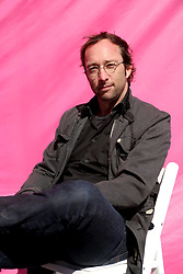 Dec 03 2007. New Orleans, Louisiana. Lower 9th Ward.<br /> Brad Pitt revisits the Lower 9th ward, devastated by Hurricane Katrina to present 'Make it Right' where architects' designs are unveiled to the public. One of the winning design Architects, Wolfram Putz of Graft, Los Angeles with a pink background for the pink project.<br /> Photo credit; Charlie Varley.