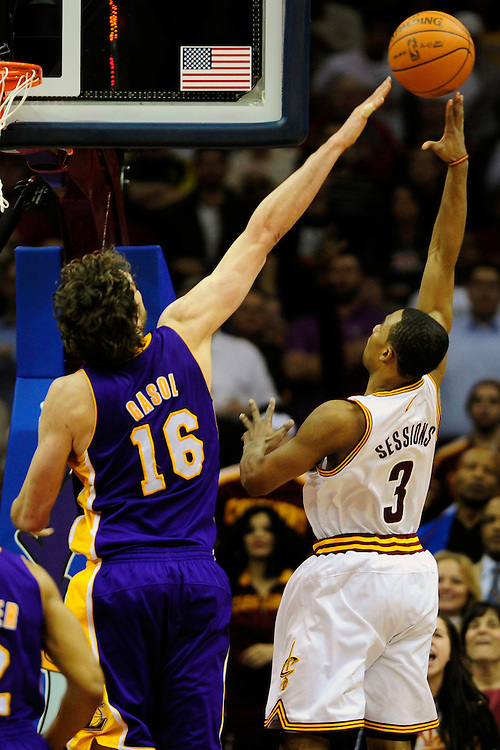 Feb. 16, 2011; Cleveland, OH, USA; Cleveland Cavaliers point guard Ramon Sessions (3) shoots over Los Angeles Lakers power forward Pau Gasol (16) during the fourth quarter at Quicken Loans Arena. The Cavaliers beat the Lakers 104-99. Mandatory Credit: Jason Miller-US PRESSWIRE