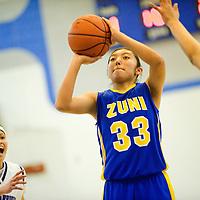 030113  Adron Gardner/Independent<br /> <br /> Zuni Thunderbird Tamara Homer (33) attempts a jump shot during the 1-2A district final in Navajo Friday.