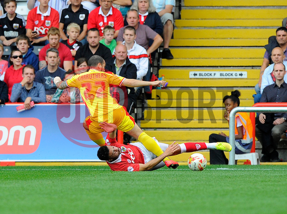 Bristol City's Derrick Williams tackles Milton Keynes Dons' Samir Carruthers  - Photo mandatory by-line: Joe Meredith/JMP - Mobile: 07966 386802 - 27/09/2014 - SPORT - Football - Bristol - Ashton Gate - Bristol City v MK Dons - Sky Bet League One