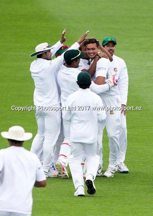 Bangladesh's Taskin Ahmed is congratulated on taking New Zealand's captain Kane Williamson. New Zealand Blackcaps v Bangladesh, ANZ International Cricket, Day 3 of the 1st test, Basin Reserve, Wellington, New Zealand. Saturday, 14 January, 2017. Copyright photo: John Cowpland / www.photosport.nz