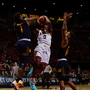 09 December 2017:  The San Diego State men's basketball team hosts the California Golden Bears Saturday afternoon. San Diego State Aztecs guard Devin Watson (0) is fouled by California Golden Bears guard Darius McNeill (1) on a shot attempts in the second half. The Aztecs lost 63-62 to Cal.<br /> www.sdsuaztecphotos.com