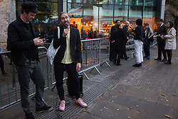 London, UK. 8 October, 2019. Oliver Wainwright, architecture and design critic at the Guardian newspaper, shows support for campaigners from Architects for Social Housing (ASH) protesting outside the award ceremony for the Riba Stirling Prize at the Roundhouse. ASH were protesting against the Royal Institute of British Architects' (RIBA) nomination of the architecture of social cleansing, estate demolition and housing privatisation for the Stirling Prize, against the false promotion of council-owned commercial housing development and management companies as a so-called 'renaissance in social housing' and against the association of the name of socially committed architect, the late Neave Brown, with the architecture of Neo-liberalism. Credit: Mark Kerrison/Alamy Live News