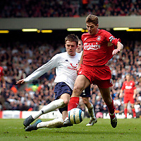 Photo. Jed Wee.<br /> Liverpool v Tottenham Hotspurs, Barclays Premiership, 16/04/2005.<br /> Liverpool's Steven Gerrard (R) is felled by a tackle from Tottenham's Michael Carrick for his team's penalty.