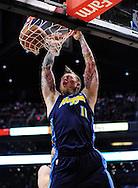 Mar. 10, 2011; Phoenix, AZ, USA; Denver Nuggets forward Chris Andersen (11) dunks the ball against the Phoenix Suns at the US Airways Center. Mandatory Credit: Jennifer Stewart-US PRESSWIRE
