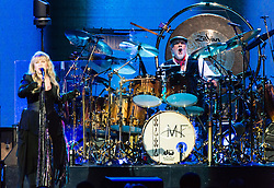 © Licensed to London News Pictures. 27/05/2015. London, UK.   Fleetwood Mac performing live at The O2 Arena, together with Christine Mc Vie who has rejoined the band.   In this picture - Stevie Nicks (left), Mick Fleetwood (right).  The band are due to headline the Isle of Wight Festival next month. Fleetwood Mac are a British-American rock band consisting of members Mick Fleetwood (drums), John McVie (bass guitar), Christine McVie (keyboards/vocals), Lindsey Buckingham (guitars, vocals), Stevie Nicks (vocals, tambourine).  Photo credit : Richard Isaac/LNP