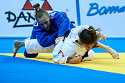 Warsaw, Poland - 2017 April 20: Noa Minster from Israel (white) competes with Monica Ungureanu from Romania (blue) in the women&rsquo;s 48kg bronze medal fight during European Judo Championships 2017 at Torwar Hall on April 20, 2017 in Warsaw, Poland.<br /> <br /> Mandatory credit:<br /> Photo by &copy; Adam Nurkiewicz / Mediasport<br /> <br /> Adam Nurkiewicz declares that he has no rights to the image of people at the photographs of his authorship.<br /> <br /> Picture also available in RAW (NEF) or TIFF format on special request.<br /> <br /> Any editorial, commercial or promotional use requires written permission from the author of image.