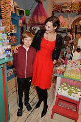 LONDON, ENGLAND 1 DECEMBER 2016: Jasmine Guinness, Otis Rainey at the 10th birthday party for the toy shop HoneyJam, 2 Blenheim Crescent, Notting Hill, London, England. 1 December 2016.