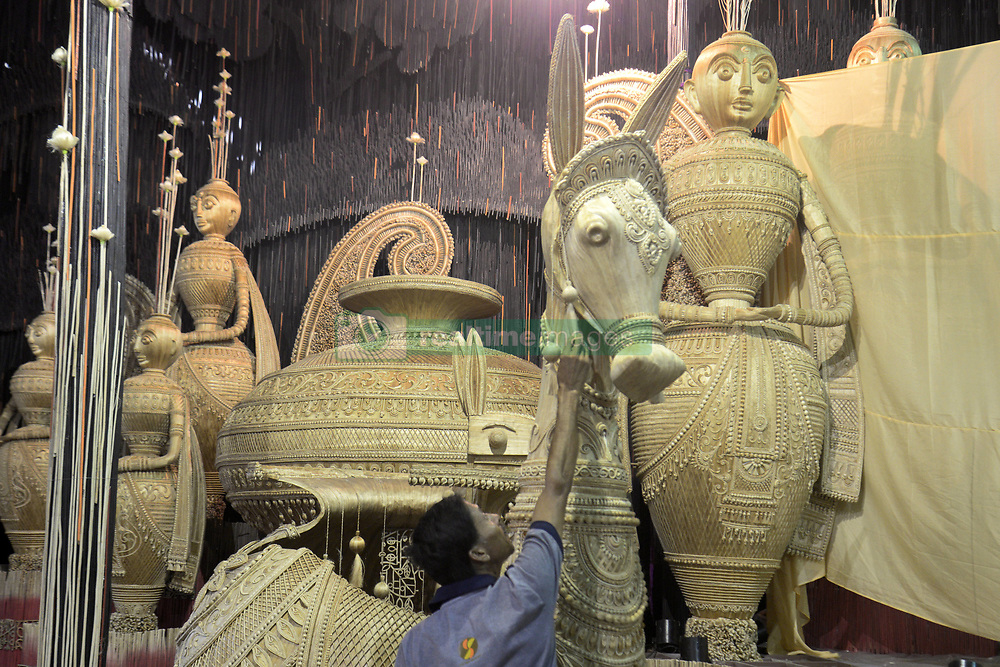 October 5, 2018 - Kolkata, West Bengal, India - Labor busy to decorates Durga Puja Pandal or temporary platform with jute product to promote Jute Industry ahead of Durga Puja Festival. The annual five days festival begins on October 15 and worship Goddess Durga who symbolized power and the triumph of good over evil in Hindu mythology..Labor busy to decorates Durga Puja Pandal or temporary platform with jute product to promote Jute Industry ahead of Durga Puja Festival. (Credit Image: © Saikat Paul/Pacific Press via ZUMA Wire)