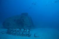 Scuba divers descend to the El Águila wreck on Roatan, Honduras