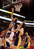 May 25, 2010; Phoenix, AZ, USA; Phoenix Suns center Robin Lopez (15) lays up a shot against Los Angeles Lakers forward Pau Gasol (16) during the first quarter in game four of the western conference finals in the 2010 NBA Playoffs at US Airways Center.  Mandatory Credit: Jennifer Stewart-US PRESSWIRE