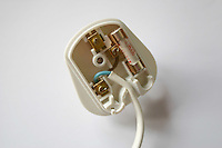 inside a three pin electrical plug with cable irish and british standard