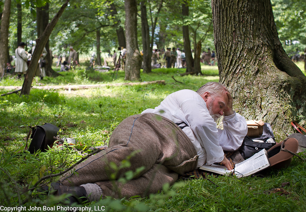 Ron Marcinko, Chaplain for the 14th Tennessee, peruses a Bible prior to taking part in the reenactment of Pickett's Charge, during the Sesquicentennial Anniversary of the Battle of Gettysburg, Pennsylvania on Sunday, June 30, 2013.  A pivotal moment in the Civil War, over 50,000 soldiers died in the Battle of Gettysburg, which spanned 3 days from July 1-3, 1863.  Later that year, President Abraham Lincoln returned to Gettysburg to deliver his now famous Gettysburg Address to dedicate the cemetery there for the Union soldiers who died in battle.  John Boal photography