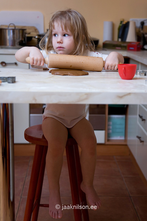 Two Year Old Girl Cooking Gingerbread Jaak Nilson Photostock