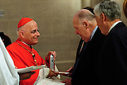 Chicago Archbishop Francis Cardinal George presents the Certificate and Insignia of the Equestrian Order of St. Gregory the Great to his legal counselor James Serritella during a Morning Prayer at the St. James Chapel at the Archbishop Quigley Center, June 23, 2012. The Papal honor is recommended by a local Bishop to recognize meritorious service to the church. Also being honored are Archdiocese of Chicago Chancellor Jimmy Lago and Finance Council Vice Chair James Denny. l Brian J. Morowczynski~ViaPhotos..For use in a single edition of Catholic New World Publications, Archdiocese of Chicago. Further use and/or distribution may be negotiated separately. ..Contact ViaPhotos at 708-602-0449 or email brian@viaphotos.com.