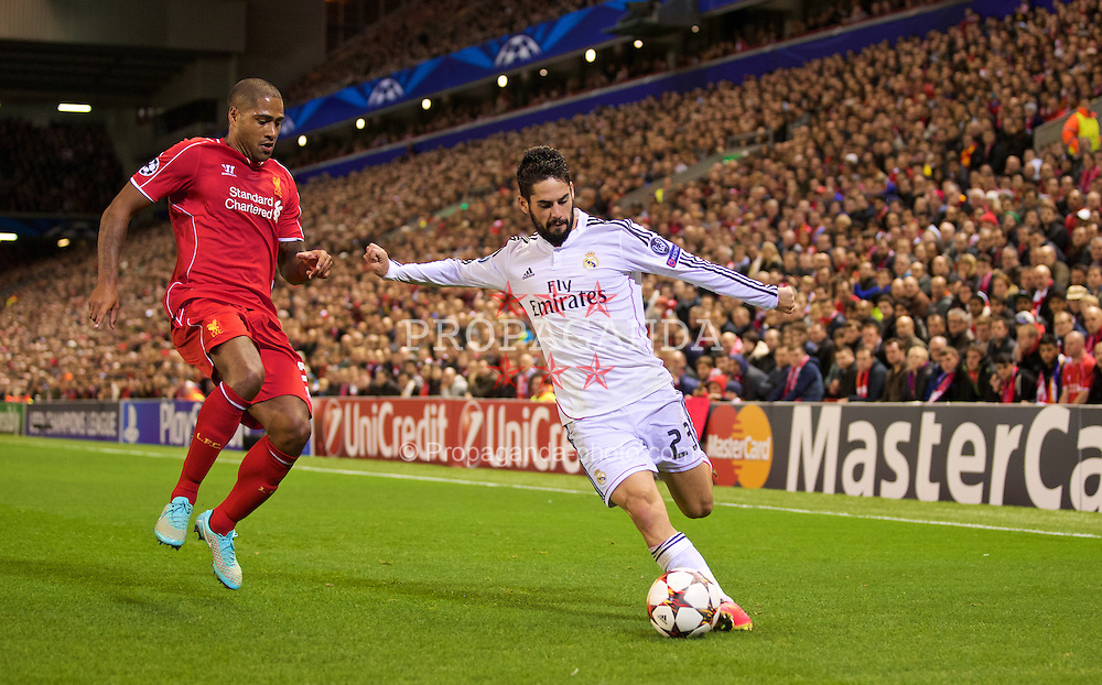LIVERPOOL, ENGLAND - Wednesday, October 22, 2014: Real Madrid CF's Isco in action against Liverpool's Glen Johnson during the UEFA Champions League Group B match at Anfield. (Pic by David Rawcliffe/Propaganda)