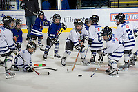 KELOWNA, CANADA, NOVEMBER 30: Kelowna Minor Hockey initiation players scrimmage on the ice between periods as the Tri City Americans visit the Kelowna Rockets  on November 30, 2011 at Prospera Place in Kelowna, British Columbia, Canada (Photo by Marissa Baecker/Shoot the Breeze) *** Local Caption ***