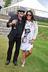 Singer BRIAN JOHNSON and his wife BRENDA at a luncheon hosted by Cartier for their sponsorship of the Style et Luxe part of the Goodwood Festival of Speed at Goodwood House, West Sussex on 1st July 2012.