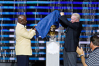 07 August 2010: Former Dallas Cowboys running back Emmitt Smith and Cowboys owner Jerry Jones reveal the Emmitt Smith bust at the enshrinement ceremony at the Pro Football Hall of Fame in Canton, Ohio.
