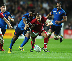 Mathieu Bastareaud of France battles for the ball with Nick Blevins of Canada  - Mandatory byline: Joe Meredith/JMP - 07966386802 - 01/10/2015 - Rugby Union, World Cup - Stadium:MK -Milton Keynes,England - France v Canada - Rugby World Cup 2015