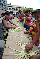 """MEXICO, Veracruz, Tantoyuca, Oct 27- Nov 4, 2009. Citizens learn how to make palm-frond traditional altar decorations in Papantla's """"zocalo."""" """"Xantolo,"""" the Nahuatl word for """"Santos,"""" or holy, marks a week-long period during which the whole Huasteca region of northern Veracruz state prepares for """"Dia de los Muertos,"""" the Day of the Dead. For children on the nights of October 31st and adults on November 1st, there is costumed dancing in the streets, and a carnival atmosphere, while Mexican families also honor the yearly return of the souls of their relatives at home and in the graveyards, with flower-bedecked altars and the foods their loved ones preferred in life. Photographs for HOY by Jay Dunn."""