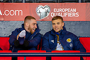 Oliver McBurnie (#20) of Scotland (left) shares a joke with Ryan Porteous (#23) of Scotland on the bench before the UEFA European 2020 Group I qualifier match between Scotland and Kazakhstan at Hampden Park, Glasgow, United Kingdom on 19 November 2019.