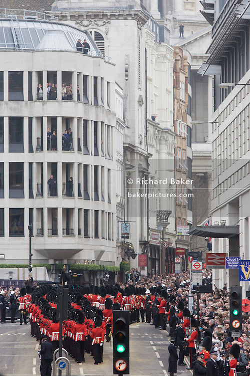 Guardsmen march up Ludgate Hill before the funeral of Margaret Thatcher. Draped in the union flag and mounted on a gun carriage, the coffin of ex-British Prime Minister Baroness Margaret Thatcher's coffin travels along Fleet Street towards St Paul's Cathedral in London, England. Afforded a ceremonial funeral with military honours, not seen since the death of Winston Churchill in 1965, family and 2,000 VIP guests (incl Queen Elizabeth) await her cortege.