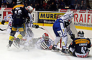 Kloten Flyers forward Michael Liniger (R) has been stopped by ZSC Lions goaltender Ari Sulander (C) and Mark Bastl (2nd R) during ice hockey game five of the Swiss National League A Playoff Quarterfinal between Kloten Flyers and ZSC Lions held at the Kolping Arena in Kloten, Switzerland, Tuesday, March 8, 2011. (Photo by Patrick B. Kraemer / MAGICPBK)