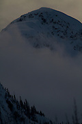 Snow capped peak rises behind Squamish, British Columbia, Canada